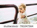 baby gooking serious near the...   Shutterstock . vector #781047364