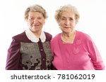 older friends embrace and laugh | Shutterstock . vector #781062019