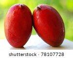 Two tropical mango fruits. - stock photo