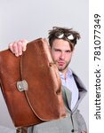 Small photo of Man with briefcase isolated on white background. Serious man or professor with bristle in nerd glasses. Nerd wearing classic jacket. Education and work concept.