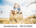 Couple With Dog Having Fun Wit...