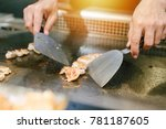 hand of man take cooking of... | Shutterstock . vector #781187605