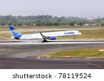 DUSSELDORF, GERMANY - MAY 20: Boeing 757 landed in airport on May, 20 2011 in Dusseldorf. Thomas Cook is one of the world leading travel groups and has 86 aircraft operated by five holiday airlines - stock photo