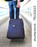 Traveler with a suitcase on the speed walk - stock photo