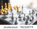 gold and silver chessmen on... | Shutterstock . vector #781328779