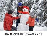 winter fun. a girl  a man and a ... | Shutterstock . vector #781388374