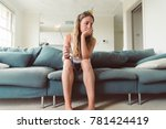 sad bored woman at a party... | Shutterstock . vector #781424419