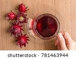 hand hold an organic roselle... | Shutterstock . vector #781463944
