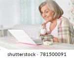 senior woman working with laptop | Shutterstock . vector #781500091