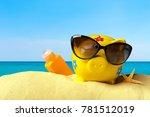 piggy bank on a beach. vacation ... | Shutterstock . vector #781512019