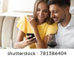 couple in love looking on phone ... | Shutterstock . vector #781586404