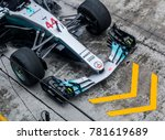 Small photo of SEPANG, MALAYSIA - SEPTEMBER 28, 2017 : Team members of Mercedes British driver Lewis Hamilton practice a pit stop ahead of the Malaysia Formula One (F1) Grand Prix at Sepang International Circuit.