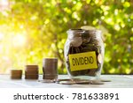 Small photo of Dividend with coins in glass jar and coin stack grow. Finance to investing money,saving and dividend. concept investment growing finance.
