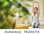 young woman with outstretched... | Shutterstock . vector #781656751