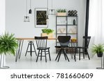 Black Chairs At Dining Table I...