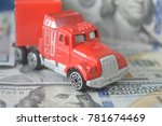 a toy car on money background | Shutterstock . vector #781674469