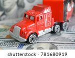 a toy car on money background | Shutterstock . vector #781680919