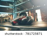 boxing glove on boxing ring in... | Shutterstock . vector #781725871