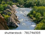 a blue river flowing between... | Shutterstock . vector #781746505