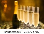 many glasses of champagne in a... | Shutterstock . vector #781775707