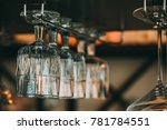 empty glasses for wine above a... | Shutterstock . vector #781784551