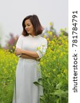 Small photo of The woman in an ao dai