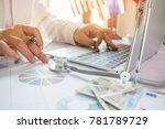 doctor working on laptop... | Shutterstock . vector #781789729