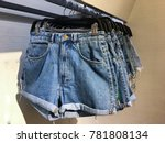 shorts jeans on a hanger on the ...   Shutterstock . vector #781808134