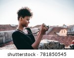 focused young curly african... | Shutterstock . vector #781850545