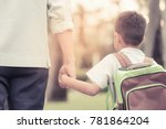 father and son hold hands... | Shutterstock . vector #781864204