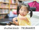 little asian girl scratching... | Shutterstock . vector #781866805