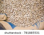 raw coffee beans in the sack... | Shutterstock . vector #781885531