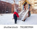 child playing on a wooden slide ... | Shutterstock . vector #781885984