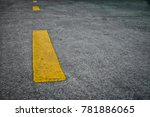 Small photo of Road surface with yellow dashed parallel to the road. The line of the car.Channel of driving.Traffic sign
