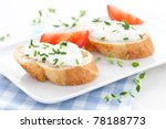 fresh baguette and cream cheese - stock photo