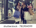 two adult women on their... | Shutterstock . vector #781904599