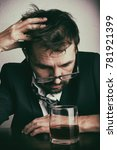 Small photo of Alcohol addiction - drunk businessman with glass of whiskey