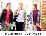 teenage friends walking at the... | Shutterstock . vector #781954255