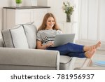beautiful woman using laptop... | Shutterstock . vector #781956937