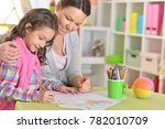 mother and daughter sitting at...   Shutterstock . vector #782010709