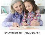 little cute girl reading book  | Shutterstock . vector #782010754