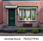 typical dutch village houses... | Shutterstock . vector #782027944