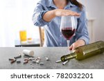 young woman covering glass of... | Shutterstock . vector #782032201