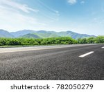country road and mountains with ... | Shutterstock . vector #782050279