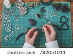 woman making costume jewelry.... | Shutterstock . vector #782051011