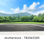 country road and mountains with ...   Shutterstock . vector #782065285