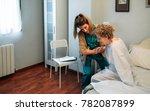 female caregiver helping... | Shutterstock . vector #782087899