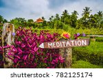 "Wooden Sign with the Word ""Meditation"" Painted On in the Middle of a Lush Tropical Jungle.  Located in Bali, Indonesia at Bali Silent Retreat."