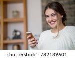 pretty girl talking on the phone | Shutterstock . vector #782139601