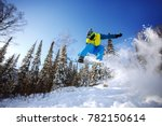 snowboarder jumping through air ... | Shutterstock . vector #782150614